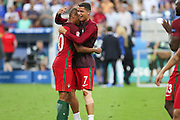 Portugal Midfielder Ricardo Quaresma and Portugal Forward Cristiano Ronaldo celebrate during the Euro 2016 final between Portugal and France at Stade de France, Saint-Denis, Paris, France on 10 July 2016. Photo by Phil Duncan.