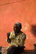 A man drinks tea in a Jaipur bazaar, Jaipur, India