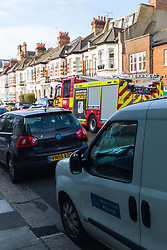 A forensics van and fire truck parked outside the victorian terrace where a 'small, contained' fire in an upstairs flat in Burnfoot Avenue, Fulham, claimed the life of a woman. Fulham, London. February 07 2018.