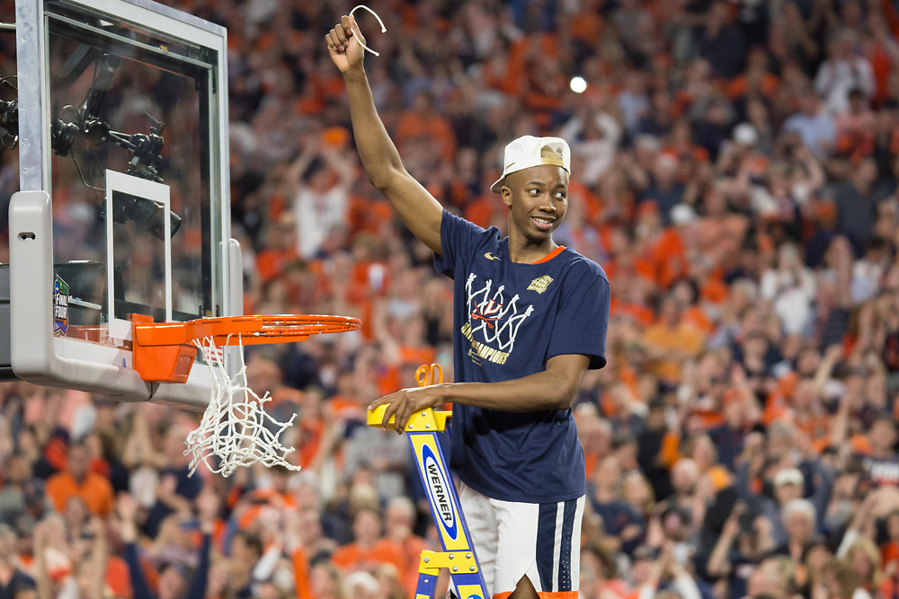 Mamadi Diakite cutting down the net after Virginia wins the 2019 NCAA Men's Basketball National Championship on April 8, 2019.