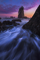 Rushing waves and colorful clouds after sunset along Second Beach in Olympic National Park, Washington USA