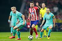 Atletico de Madrid's Saul Niguez (c) and FC Barcelona's Ivan Rakitic (l) and Andres Iniesta during La Liga match. October 14,2017. (ALTERPHOTOS/Acero)