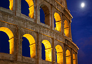 """The Colosseum, or the Coliseum, originally the Amphitheatrum Flavium (English: Flavian Amphitheatre, Italian: Anfiteatro Flavio or Colosseo), the largest amphitheatre in the world, is an elliptical amphitheatre in the centre of the city of Rome, Italy, the largest ever built in the Roman Empire, built of concrete and stone. It is considered one of the greatest works of Roman architecture and Roman engineering.<br /> Occupying a site just east of the Roman Forum, its construction started in 70 AD under the emperor Vespasian and was completed in 80 AD under Titus, with further modifications being made during Domitian's reign (81–96). The name """"Amphitheatrum Flavium"""" derives from both Vespasian's and Titus's family name (Flavius, from the gens Flavia).<br /> Capable of seating 50,000 spectators, the Colosseum was used for gladiatorial contests and public spectacles such as mock sea battles, animal hunts, executions, re-enactments of famous battles, and dramas based on Classical mythology. The building ceased to be used for entertainment in the early medieval era. It was later reused for such purposes as housing, workshops, quarters for a religious order, a fortress, a quarry, and a Christian shrine.<br /> Although in the 21st century it stays partially ruined because of damage caused by devastating earthquakes and stone-robbers, the Colosseum is an iconic symbol of Imperial Rome. It is one of Rome's most popular tourist attractions and still has close connections with the Roman Catholic Church, as each Good Friday the Pope leads a torchlit """"Way of the Cross"""" procession that starts in the area around the Colosseum."""