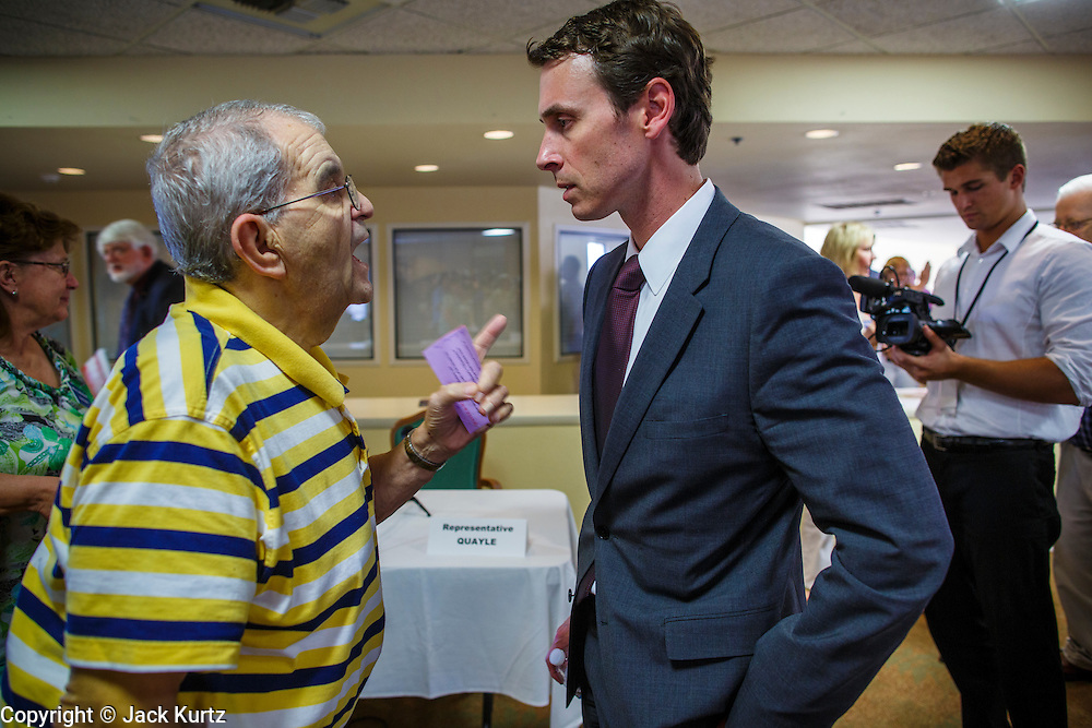 """09 AUGUST 2012 - SCOTTSDALE, AZ: Congressman BEN QUAYLE (R-AZ) talks to a constiuent who complained to Quayle about what he called the Republicans """"war"""" on women's health care after a candidate forum at an adult assisted living facility in Scottsdale, AZ, Thursday. Quayle told the man that President Obama didn't respect corporations' religious rights when he mandated contraceptive health care. Republican Congressmen Ben Quayle and David Schweikert are facing each other in Arizona's Aug. 28 Republican primary. They are vying for the right to represent Arizona's 6th Congressional District. Both men are incumbent freshmen Congressmen. They were thrown into the same district during the redistricting process after the 2010 census. Both men are conservatives courting the Tea Party vote.    PHOTO BY JACK KURTZ"""