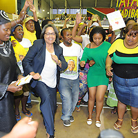 KHAYELITSHA, SOUTH AFRICA - Monday 9 December 2013, the City of Cape Town hosted an Evening of Remembrance at the OR Tambo hall, Khayelitsha. for the late former President of South Africa, Nelson Mandela. The Executive Mayor of Cape Town, Mrs Patricia De Lille, dances with the crowd to old struggle songs.<br /> Photo by Roger Sedres/ImageSA