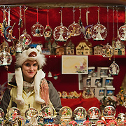 VERONA, ITALY - DECEMBER 04:  A stall holder sells Christmas bubble at her wodden hut at the Verona Christmas Market on December 4, 2010 in Verona, Italy. Christmas markets, fairs, lights and nativity scenes fill Northern Italian cities and villages from December through January 6.