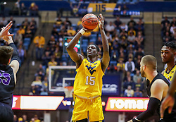 Mar 20, 2019; Morgantown, WV, USA; West Virginia Mountaineers forward Lamont West (15) shoots a three pointer during the second half against the Grand Canyon Antelopes at WVU Coliseum. Mandatory Credit: Ben Queen