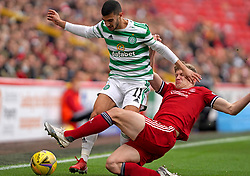 Celtic's Liel Abada (left) and Aberdeen's Jack MacKenzie battle for the ball during the cinch Premiership match at Pittodrie Stadium, Aberdeen. Picture date: Sunday October 3, 2021.
