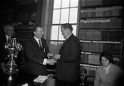 06/05/1965<br /> 05/06/1965<br /> 06 May 1965<br /> Presentation of the Read Cup for quality Butter production at the RDS, Ballsbridge, Dublin. Image shows Mr Charles Haughey, (2nd from left)) Minister for Agriculture presenting medal  to Mr Michael O'Leary, Manager of the Dairy Disposal Company creamery at Castletownbere, Co. Cork. On left is Mr John Henigan (Cork), Chairman Dairy Disposal Co. creamery and on right is  Maura Harrington, Castletownbere Buttermakers.