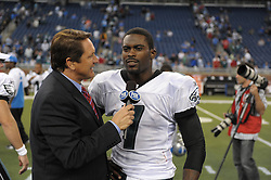 DETROIT - SEPTEMBER 19: Quarterback Michael Vick #7 of the Philadelphia Eagles gets interviewed after the game against the Detroit Lions on September 19, 2010 at Ford Field in Detroit, Michigan. (Photo by Drew Hallowell/Getty Images)  *** Local Caption *** Michael Vick