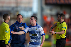 Ref alan Muir books Morton's Lewis Strapp after he came onto the park after being injured after a tackle on Dundee United's Paul McMullan. Dundee United 6 v 0 Morton, Scottish Championship game played 28/9/2019 at Dundee United's stadium Tannadice Park.