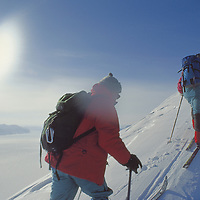 Expedition skiers climb Nemtinov Peak above Tunabreen Glacier.