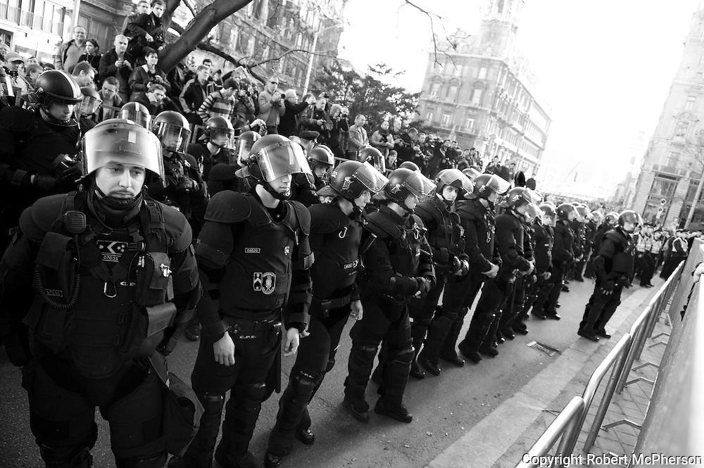 """Police separating right-wing extremists from the liberals during a demonstration in Budapest March 2012. <br /> <br /> In March 2012 right-wing extremists group called """"64 Counties Movement"""" attended a liberals demonstration to create fear and provoke in Budapest. They greeted the liberals by calling them dirty jews and to hell with Trianon. These were members who broke into the national tv station in 2006 and created riots on the streets of Budapest for several weeks.<br /> <br /> An old member of """"64 Counties Movement"""" Gyòrgy Budahàzy who for the moment is under house arrest after being in jail for 2,5 years held a speech to his supporters during this demonstration. He is still under court trial with charges of terrorism. One of the charges is trying to kill several politicians in Hungary. He is also charged for trying to set up a terrorist organization similar to IRA."""