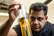 Vishal Gauri checks the alcohol proofing of his whiskey at 10th Street Distillery in San Jose, California, on September 4, 2019. (Stan Olszewski for Content Magazine)