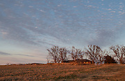 A rural farmhouse west of Crescent Oklahoma at sunset
