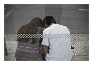 'Young couple at a bus stop, 2013', from 'The Recession Will Not Be Televised' by Colin McPherson, a body of photographic work which looks at the visual representation of the ongoing economic crisis in Porto, Portugal.<br />