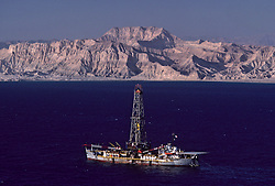 Stock photo of an oil tanker and rig