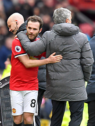 Manchester United manager Jose Mourinho congratulates Juan Mata at the end of the match