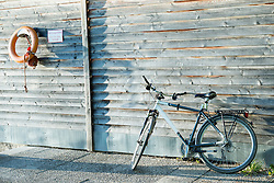 Mountainbike bicycle leaning on wooden shed