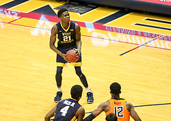 Feb 10, 2018; Morgantown, WV, USA; West Virginia Mountaineers forward Wesley Harris (21) pauses before shooting during the first half against the Oklahoma State Cowboys at WVU Coliseum. Mandatory Credit: Ben Queen-USA TODAY Sports