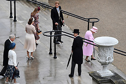 RETRANSMITTED CORRECTING BYLINE Queen Elizabeth II and the Duke of Sussex arrive for a Royal Garden Party at Buckingham Palace in London.