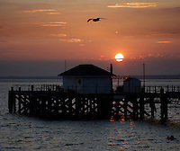 Totland pier on a summers evening at Totland Bay, Isle of Wight