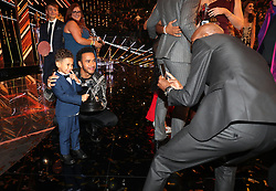 Sir Mo Farah takes a photo of his son Hussein with Lewis Hamilton poses during the BBC Sports Personality of the Year 2018 at Birmingham Genting Arena.