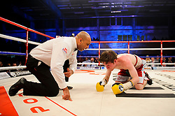Luke Wilton is counted out of his Bantamweight bout handing victory to his opponent Lee Haskins  - Photo mandatory by-line: Rogan Thomson/JMP - Tel: 07966 386802 - 01/03/2014 - SPORT - BOXING - The City Academy, Bristol - James DeGale v Gevorg Khatchikian.
