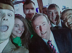 © Licensed to London News Pictures . 10/03/2014 . Manchester , UK . Photo taken from the phone of barman who took the selfie . Enda Kenny poses for a selfie with barman Fabian Bohan-taghian (left) . The Taoiseach ( Prime Minister of Ireland ) , ENDA KENNY , on a visit to Manchester today (10th March 2014) . Kenny Photo credit : Joel Goodman/LNP