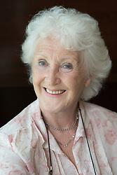 Portrait of older woman smiling,