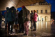 Some African migrants sheltered from the rain and cold under the arches of Irun City Council. Irun (Basque Country). October 29, 2018. A group of volunteers has created a host network to serve migrants and inform about the public services they are entitled to and the ways to cross the border. This group of volunteers is avoiding a serious humanitarian problem Irun, the Basque municipality on the border with Hendaye. As the number of migrants arriving on the coasts of southern Spain incresead, more and more migrants are heading north to the border city of Irun. French authorities have reacted by conducting random checks as far as the city of Bordeaux, more than 200 kilometers north of the border. Migrants who are caught are then deported back to Irun. (Gari Garaialde / Bostok Photo).