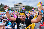 """15 NOVEMBER 2013 - BANGKOK, THAILAND: An anti-government protester cheers during an anti-government protest in Bangkok. Tens of thousands of Thais packed the area around Democracy Monument in the old part of Bangkok Friday night to protest against efforts by the ruling Pheu Thai party to pass an amnesty bill that could lead to the return of former Prime Minister Thaksin Shinawatra. Protest leader and former Deputy Prime Minister Suthep Thaugsuban announced an all-out drive to eradicate the """"Thaksin regime."""" The protest Friday was the biggest since the amnesty bill issue percolated back into the public consciousness. The anti-government protesters have vowed to continue their protests even though the Thai Senate voted down the bill, thus killing it for at least six months.     PHOTO BY JACK KURTZ"""