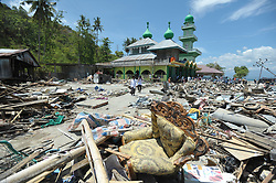 October 5, 2018 - Palu, Central Sulawesi, Indonesia - Muslims cross the remnants of a ruined building with a quake after Friday prayers, in Donggala, Central Sulawesi, Indonesia, 05 October 2018. Many places of worship were destroyed in the earthquake and tsunami such as mosques and churches, at least 1,424 people were killed after a series of powerful earthquakes struck Central Sulawesi on September 28, 2018, which triggered a tsunami. (Credit Image: © Dasril Roszandi/NurPhoto/ZUMA Press)