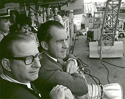 Aboard USS Hornet - (FILE) -- United States President Richard M. Nixon and Dr. Thomas O. Paine, NASA Administrator, watch Apollo 11 astronauts Neil A. Armstrong, Michael Collins and Buzz Aldrin Jr., walk from the recovery helicopter to the Mobile Quarantine Facility aboard the U.S.S. Hornet on July 24, 1969. The President later congratulated the astronauts by microphone, speaking through a window of the quarantine trailer. During the eight-day space mission, Armstrong and Aldrin explored the Moon's surface and brought back rock samples for scientists to study. Collins piloted the command module in the lunar orbit during their 22-hour stay on the moon. The extravehicular activity lasted more than two hours. Handout Photo by NASA via CNP/ABACAPRESS.COM