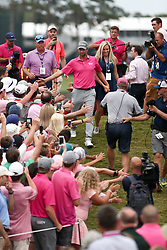 May 13, 2018 - Ponte Vedra Beach, Florida, United States - Webb Simpson (L) walks off the 18th green with his wife Taylor after winning The PLAYERS Championship at TPC Sawgrass. (Credit Image: © Debby Wong via ZUMA Wire)
