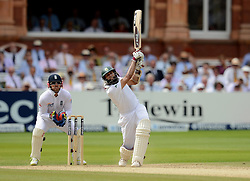 South Africa's Hashim Amla hits a boundary during the Third Investec Test Match at Lord's Cricket Ground, London.