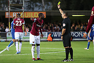 West Ham United midfielder Pedro Obiang (14) yellow card during the EFL Carabao Cup 2nd round match between AFC Wimbledon and West Ham United at the Cherry Red Records Stadium, Kingston, England on 28 August 2018.