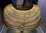 The Mold gold cape. from Flintshire, North Wales, Bronze Age, about 1900-1600 BC. Workmen quarrying for stone in an ancient burial mound in 1833 found this unique ceremonial gold cape, which remains unparalleled to this day. The mound lay in a field named Bryn yr Ellyllon (the Fairies' or Goblins' Hill). The cape would have been unsuitable for everyday wear because it would have severely restricted upper arm movement. Instead it would have served ceremonial roles, and may have denoted religious authority.