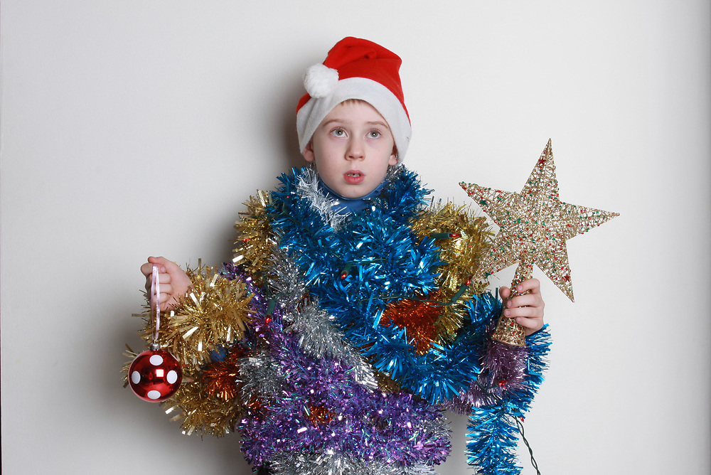 Young children dressed like a Christmas tree