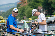 Lucerne, SWITZERLAND, 12th July 2018, Thursday  FISA World Cup series, No.3, Lake Rotsee, Lucerne, NED, Coaches, checking the boat, (L) Diederik SIMON, (R) Titus WEIJSCHIED,