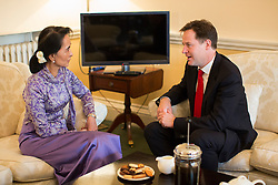 © licensed to London News Pictures. London, UK 23/10/2013. Deputy Prime Minister Nick Clegg meeting with Aung San Suu Kyi at Dover House, London on Wednesday, 23 October 2013. Photo credit: Tolga Akmen/LNP