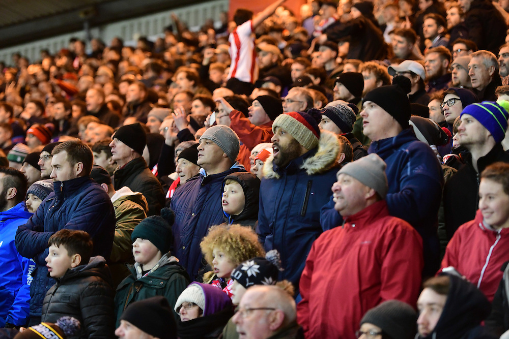 Lincoln City fans during the second half<br /> <br /> Photographer Chris Vaughan/CameraSport<br /> <br /> Emirates FA Cup Third Round Replay - Lincoln City v Ipswich Town - Tuesday 17th January 2017 - Sincil Bank - Lincoln<br />  <br /> World Copyright © 2017 CameraSport. All rights reserved. 43 Linden Ave. Countesthorpe. Leicester. England. LE8 5PG - Tel: +44 (0) 116 277 4147 - admin@camerasport.com - www.camerasport.com