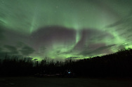 A trucker takes a rest break just north of Nenana as the Aurora Borealis swirls overhead