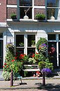 Quaint well-kept renovated traditional houses in the upmarket Noordermarkt - Northern Market  area of Jordaan, Amsterdam