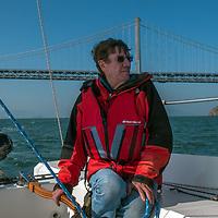 Photographer Gordon Wiltsie sails a boat on San Francisco Bay, California.