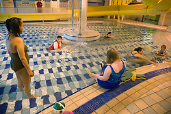 Day Service officer and Care assistant supervising a group of women day service users with learning disabilities at a local swimming pool,