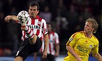 Photo: Paul Thomas.<br />PSV Eindhoven v Liverpool. UEFA Champions League, Quarter Final, 1st Leg. 03/04/2007.<br /><br />Phillip Cocu (L) of PSV battles with Dirk Kuyt.