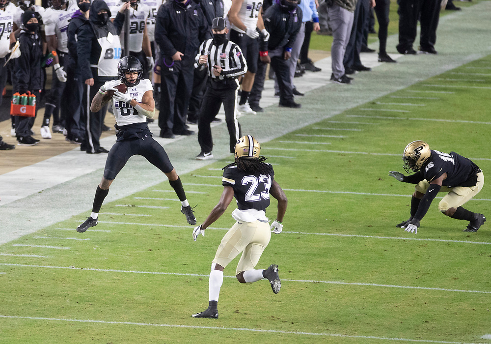November 14, 2020:  Northwestern wide receiver Ramaud Chiaokhiao-Bowman (81) catches the ball as Purdue safety Cory Trice (23) pursues during NCAA football game action between the Northwestern Wildcats and the Purdue Boilermakers at Ross-Ade Stadium in West Lafayette, Indiana. Northwestern defeated Purdue 27-20.  John Mersits/CSM.