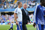 Guus Hiddink, the interim Chelsea manager talks to John Terry, the Chelsea captain during full time during a walk around the pitch. Barclays Premier league match, Chelsea v Leicester city at Stamford Bridge in London on Sunday 15th May 2016.<br /> pic by John Patrick Fletcher, Andrew Orchard sports photography.