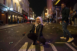 © Licensed to London News Pictures.  01/05/2021. London, UK. Members of the public make the most of Saturday night out in Soho, central London after pubs and restaurants closed. Photo credit: Marcin Nowak/LNP